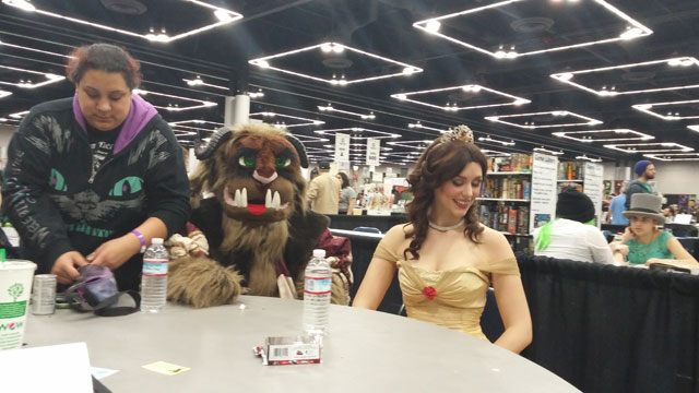 The Beast and Belle sit down for a snack.